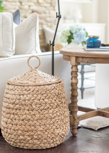 Family room toy storage in natural woven basket