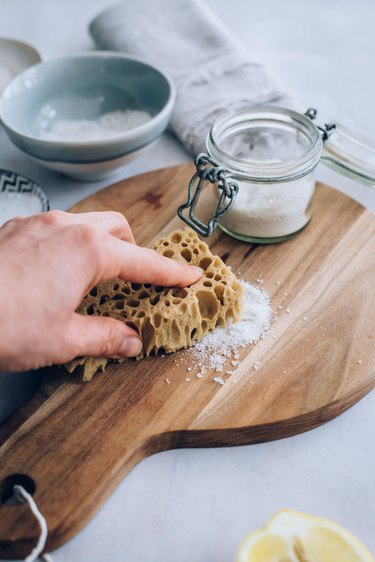 Using wooden cutting board scrub to disinfect