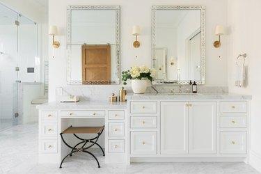upholstered bathroom vanity lighting ideas over white cabinet