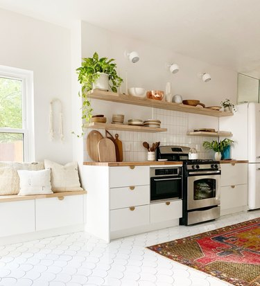 Scandinavian kitchen floor tile in white fish scale with white cabinets