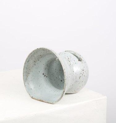 Off-white ceramic lo-fi speaker.