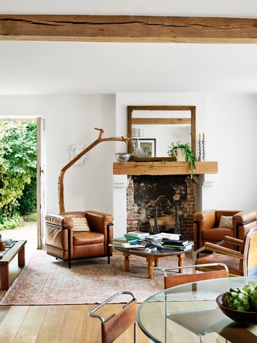 French country living room ideas with brick fireplace and wood mantel