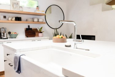 Kitchen sink with mirror in background