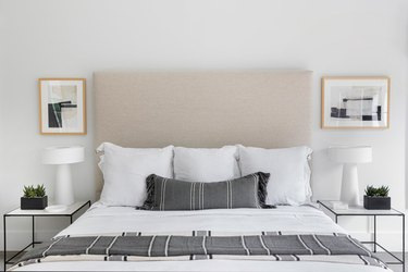 bedroom with black and white bedding