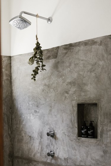 close up of shower spout with eucalyptus hanging