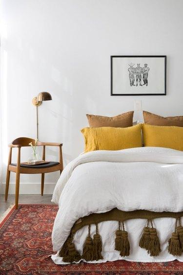 Vintage bedroom idea with chair in corner