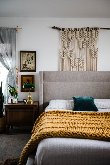 Vintage bedroom idea with yellow blanket