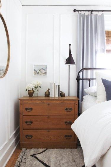 Vintage bedroom idea with vintage dresser