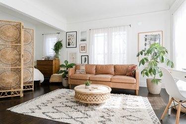 Minimalist-bohemian studio with white walls and organic accents