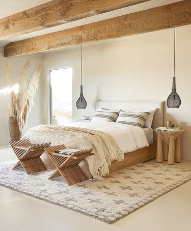 bedroom space with two hanging lighting fixtures