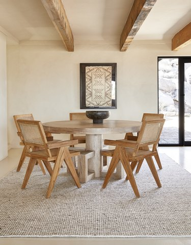 dining space with wicker and wood chairs