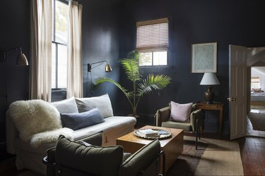 dark blue family room with linen family room window treatments
