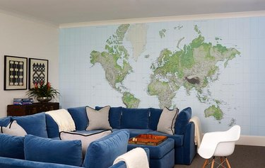 family room wall ideas with large map and blue u-shaped couch