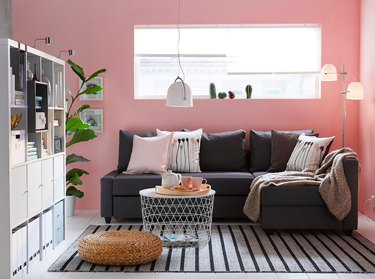 pink living room with sectional sofa