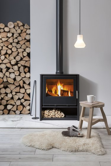 Scandinavian fireplace idea with freestanding wood burning stove