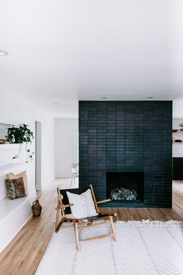 Scandinavian fireplace idea with black brick tile