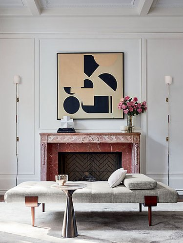 art deco apartment with white living room with fireplace and large wall art