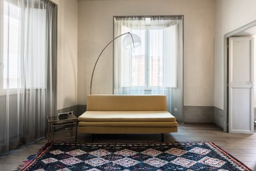 sheer family room window treatments with small yellow sofa