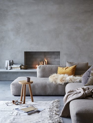 Scandinavian fireplace idea with simple silhouette