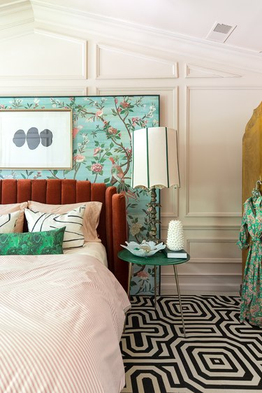art deco colors in bedroom with black and white geometric carpet and floral turquoise mural