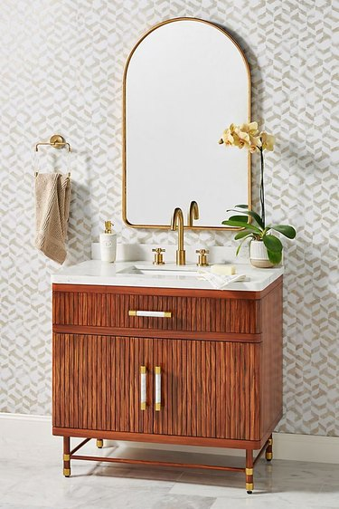 art deco apartment bathroom with wooden vanity and mirro