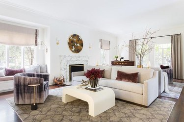 velvet family room window treatments in white family room with cream coffee table and roman shades