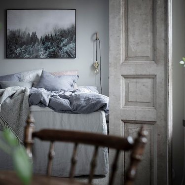Scandinavian farmhouse style bedroom with grayish blue palette