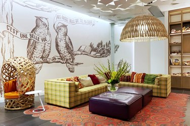 basement family room ideas with wall art and colorful rug
