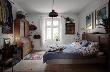 Scandinavian farmhouse style bedroom with wood furniture