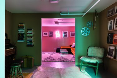 basement family room ideas with bearskin rug, neon light, and fur covered chair