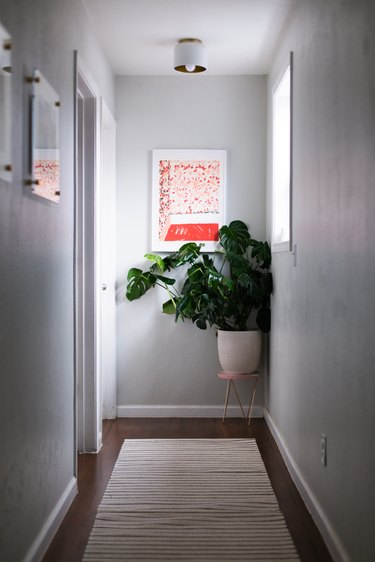 midcentury modern hallway lighting with small ceiling light.