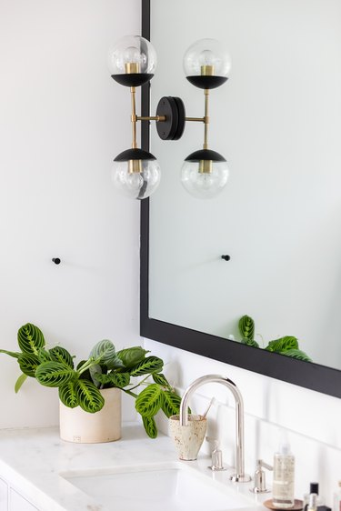 dual bulb minimalist lighting sconce in bathroom
