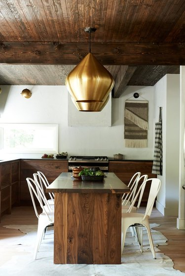 modern rustic farmhouse eat-in kitchen with walnut wood table and cabinets