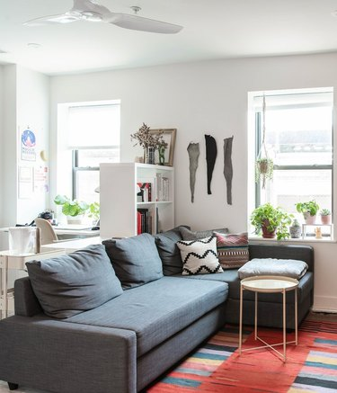 small space living room with sectional and IKEA room dividing bookcase