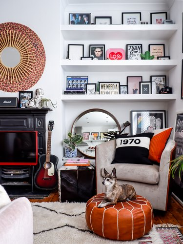 mid-century living room corner idea with built-in shelves