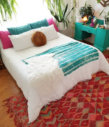 bohemian teal bedroom idea with potted plants and decorative accents
