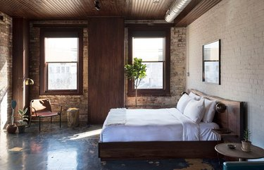 industrial hotel room with exposed wood cement and metal