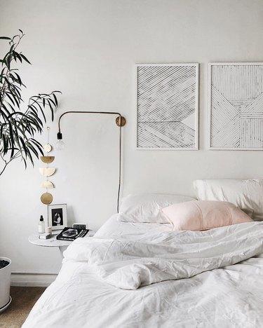 white bedroom ideas with modern artwork