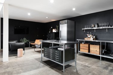 black kitchen with recessed lighting