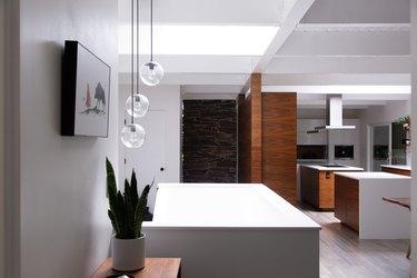 modern kitchen island with three pendant lights hanging above