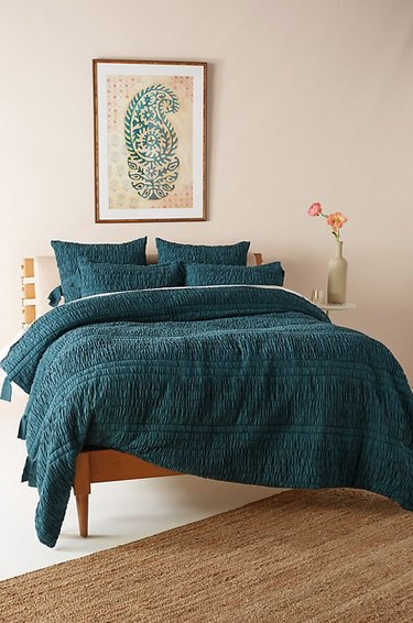 bohemian teal bedroom idea with duvet and pillows