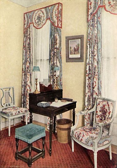 image of seating area with patterned chair and curtains