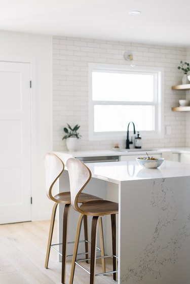 marble kitchen island ideas with seating and curved wooden chairs