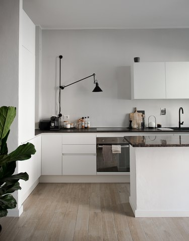 minimalist apartment ideas with gray kitchen and black fixtures