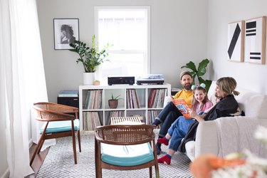 Family room with family sitting on couch among modern decor