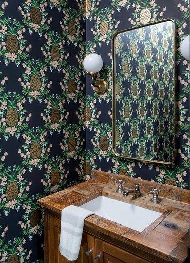 pineapple modern wallpaper in bathroom with wood sink