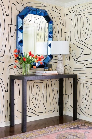 modern wallpaper with line pattern and blue entryway mirror