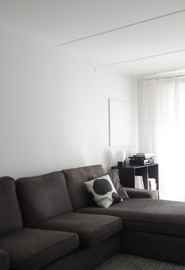minimalist apartment ideas with gray sectional and black shelf