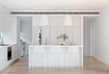 contemporary white kitchen island ideas with seating and white bar chairs
