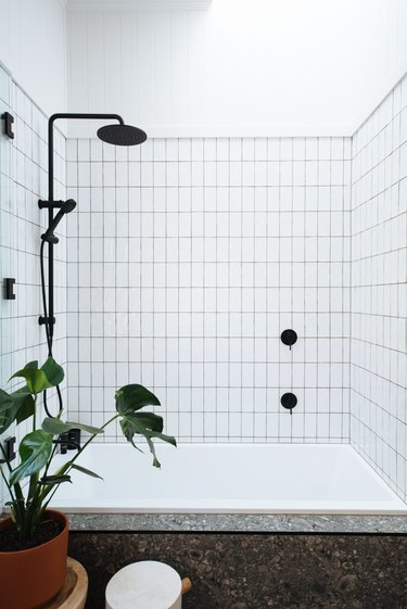 minimalist apartment ideas with grid bathroom shower tile and black shower head